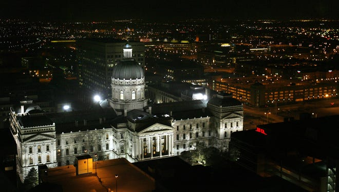 The Indiana Statehouse is lit up against the Indianapolis skyline on March 29, 2006.