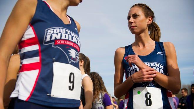 University of Southern Indiana senior cross country runner Jessica Reeves (8) prepares for for the 6000 meter run with teammate Emily Roberts (9) during the NCAA Division II Midwestern Cross Country Regional at Angel Mounds, Saturday Nov, 5, 2016. Reeves finished first with a time of 20:08.