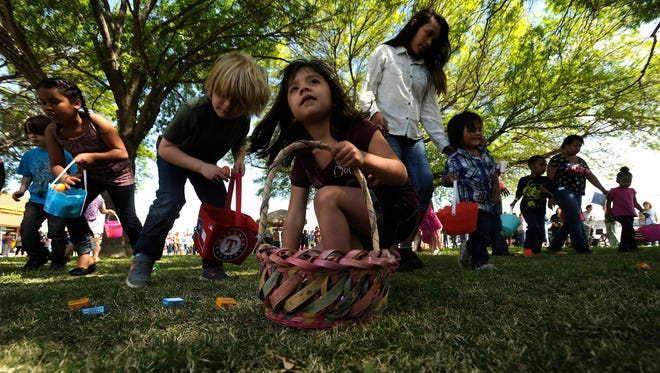 Thomas Metthe/Reporter-NewsKids search for candy-filled Easter Eggs during the community Easter Egg Hunt and Eggstravaganza on Saturday, March 26, 2016, at Southern Hills Church of Christ.