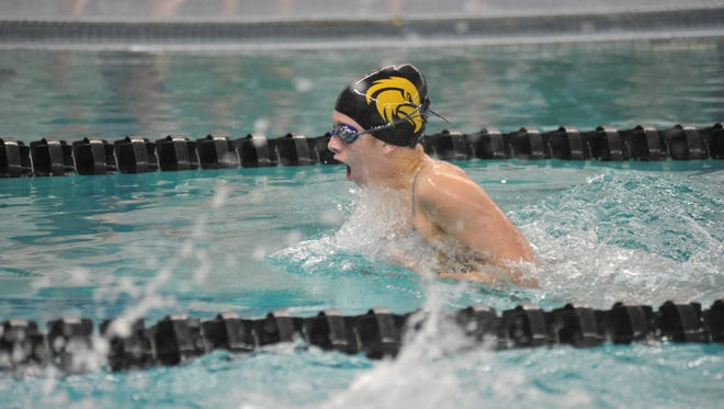 Colonel Crawford's Kaisey Speck swims the 100 breaststroke.