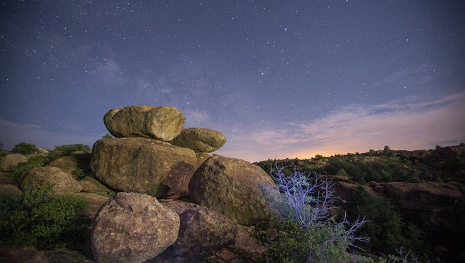 The Tetons boulders at Oak Flats at night in near Superior on June 23, 2015.