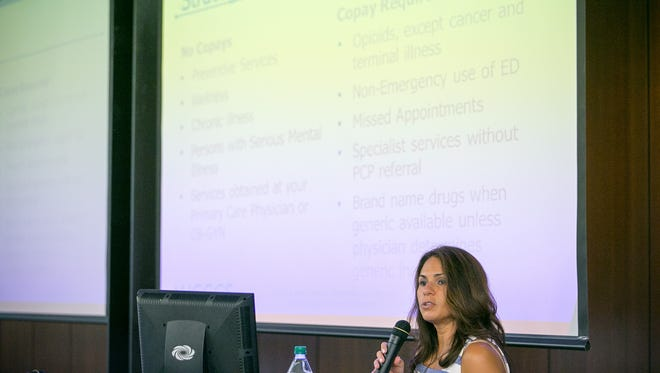 Monica Coury, assistant director of Office of Intergovernmental Relations at the Arizona Health Care Cost Containment System, speaks at a public forum to discuss the state's Medicaid reform plan at the Disability Empowerment Center in Phoenix on Tuesday, August 18, 2015.