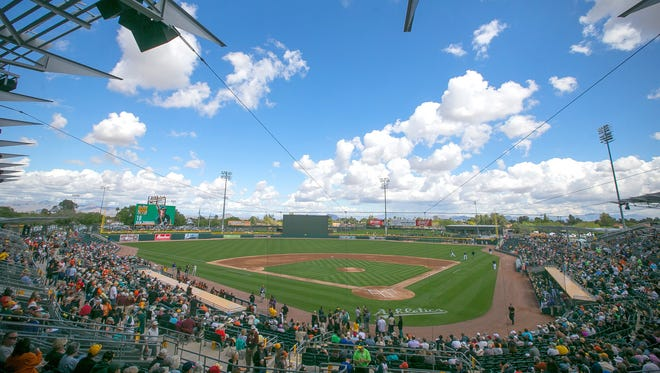 Fans filled Mesa's Hohokam Stadium to watch the Oakland Athletics take on the San Francisco Giants on opening day of the Cactus League on March 3, 2015. The renovated ballpark opened in 2015, serving as the new home to the Oakland A's.