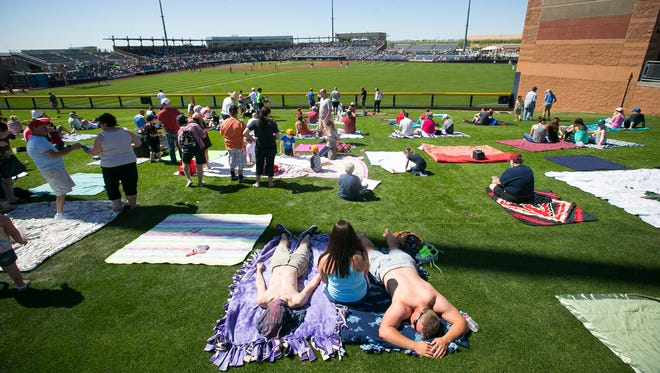 The Peoria Sports Complex, which was the first to hosts the Seattle Mariners and the San Diego Padres, opened in 1994 and was the first to host two teams. In this photo, people watch from the lawn at the Arizona Diamondbacks spring-training game against the Seattle Mariners a on March 7, 2015.