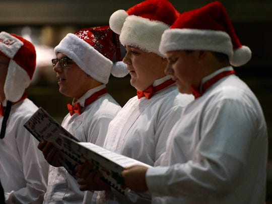 Members of the Kewaunee High School choir sing Silent Night during the annual Festival of Lights on Saturday at Lambeau Field.
