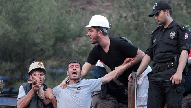 Relatives of the trapped miners react in front of the mine in Soma, a district in Turkey's western province of Manisa.
