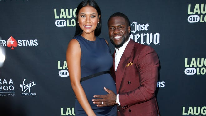 Kevin Hart and his pregnant wife Eniko Parrish pose at Kevin Hart's 'Laugh Out Loud' new streaming video network launch event in Beverly Hills on Nov. 21, 2017.