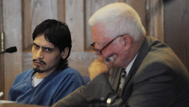 Ricky Perez and his attorney, Jerrold Schwarz, listen to Fairfield County Assisting Prosecuting Attorney Darcy Cook during Perez's hearing Tuesday in Fairfield County Common Pleas Court. Perez plead guilty to four counts of rape, all first-degree felonies, and was sentenced to 25 years in prison.