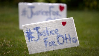 Signs are placed in a yard in Wyoming as the community prepared for the funeral of Otto Warmer, 22, at Wyoming High School. Warmbier died Monday, less then a week after being returned from North Korea in a coma, where he had been imprisoned for more than a year. The University of Virginia student had been in North Korea as part of a tour group.