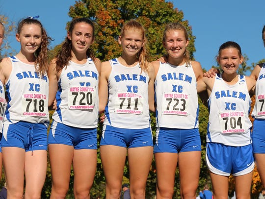 Salem's varsity girls cross country team is all smiles