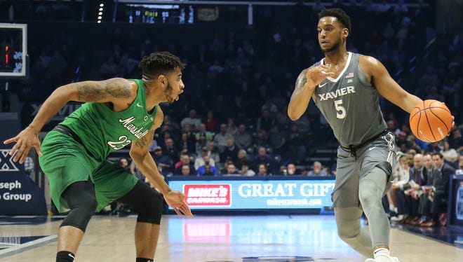 Xavier Musketeers guard Trevon Bluiett (5) drives to the basket as Marshall Thundering Herd guard Rondale Watson (23) defends in the first half during the college basketball game between the Marshall Thundering Herd and the Xavier Musketeers, Tuesday, Dec. 19, 2017, at Cintas Center in Cincinnati.