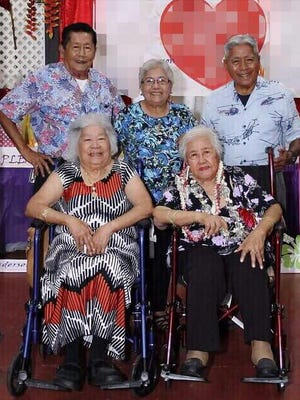 Five siblings, all survivors of World War II, will receive their honorary high school diploma at the same time. Front, from left: Julia Perez Duenas Borja, 83; and Lucy Perez Duenas Anderson, 92. Back, from right: Vicente Perez Duenas, 79; Ignacia Perez Duenas Siguenza, 82; and Joaquin Perez Duenas, 77.
