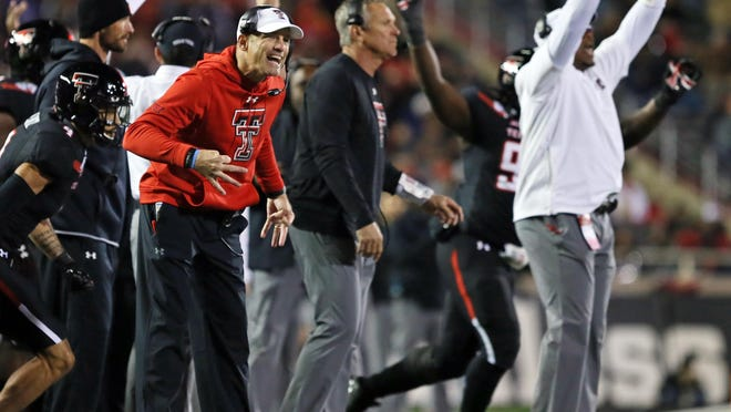 Texas Tech coach Matt Wells exhorts his team from the sideline during the Red Raiders' 30-27 loss last year to Kansas State at Jones AT&T Stadium. The Red Raiders, who have lost their past seven Big 12 games decided by a touchdown or less, are a 2 1/2-point underdog Saturday at Kansas State.