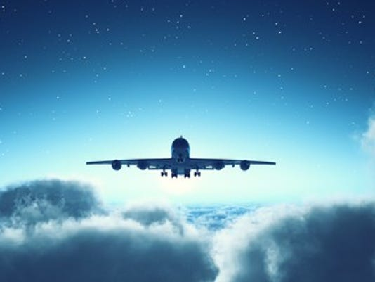 airplane-flying-above-the-clouds_large.jpg