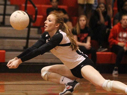 Leon's Kate Powell digs a ball during Wednesday night's