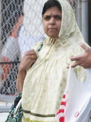 Farida Arif leaves federal court in Detroit after being