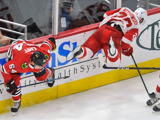 Blackhawks' David Kampf collides with Red Wings' Luke Witkowski during the second period Thursday, Sept. 21, 2017 in Chicago.