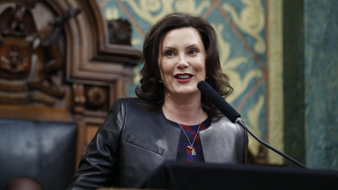 In this Jan. 29, 2020, file photo Michigan Gov. Gretchen Whitmer delivers her State of the State address to a joint session of the House and Senate at the state Capitol in Lansing. Whitmer and the Republican-controlled Legislature reached an agreement Monday, June 30, to balance the state 2020 budget after a sharp drop in state revenues resulting from the coronavirus pandemic.