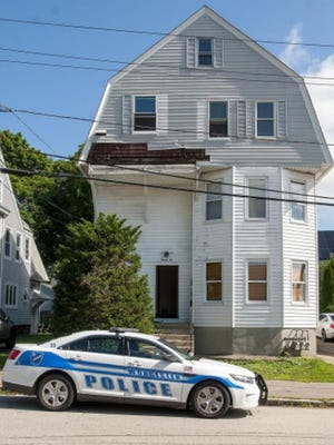 Police were called to the house on Huntington Avenue the morning of Aug. 17 for a report of two people shot.