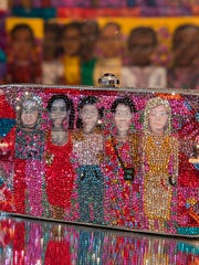 "This undated photo provided by the Museum of Arts and Design shows a rhinestone-encrusted minaudière modeled after Faith Ringgold's ""The Purple Quilt."" It is part of the exhibit ""Judith Leiber: Crafting a New York Story,"" at the museum in New York. (Jenna Bascom/Museum of Arts and Design via AP)"