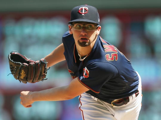 FILE - In this Aug. 4, 2019, file photo, Minnesota Twins pitcher Devin Smeltzer watches a pitch against the Kansas City Royals in the sixth inning of a baseball game in Minneapolis. The Twins remain publicly confident in the rotation anchored by returning veterans Jose Berrios and Jake Odorizzi and supplemented by youngsters like Smeltzer, Randy Dobnak and Lewis Thorpe. (AP Photo/Jim Mone, File)