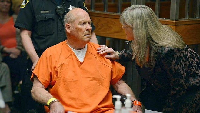 Public defender Diane Howard, right, speaks with Joseph James DeAngelo, 72, who authorities suspect is the so-called Golden State Killer responsible for at least a dozen murders and 50 rapes in the 1970s and 80s, as he makes his initial appearance, Friday, April 27, 2018, in Sacramento County Superior Court in Sacramento, Calif.
