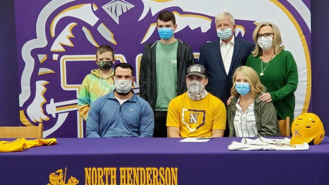 With his family watching, North Henderson senior pitcher Nate Toney signs with Paul D Camp Community College on Thursday at North's Media Center.