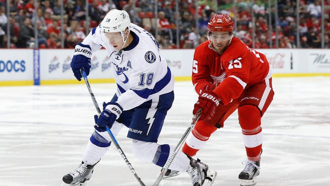 Detroit Red Wings center Riley Sheahan, right, steals the puck from Tampa Bay Lightning left wing Ondrej Palat on Nov. 15, 2016, in Detroit.