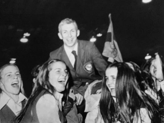 St. Rose coach Pat McCann is hoised onto the shoulders of fans and surrounded by cheerleaders after the Purple Roses won the South Jersey Non-Public B title in 1971.