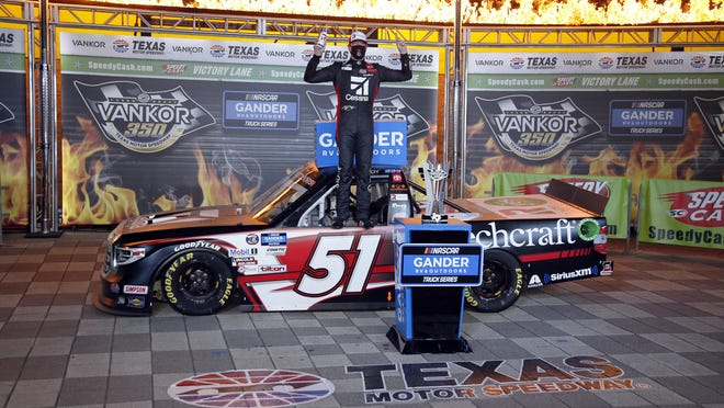Kyle Busch celebrates in victory lane after winning a NASCAR Trucks race at Texas Motor Speedway in Fort Worth, Texas, on Saturday night.