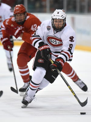 St. Cloud State's Joey Benik skates with the puck during a game at the Herb Brooks National Hockey Center. Benik, who has been a goal scorer throughout his career, leads the Huskies with seven goals in 10 games.