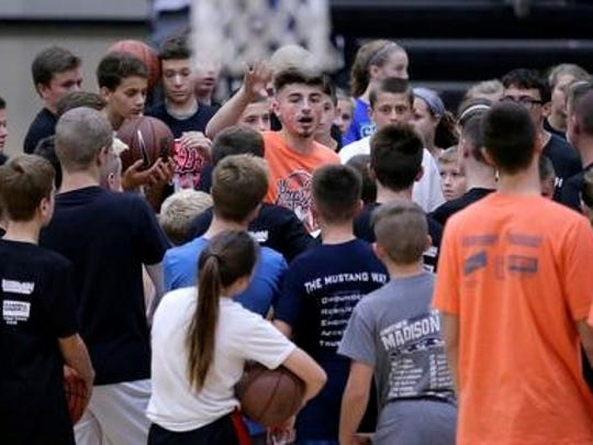 Jordan McCabe talks to camp members at the Hoops 2 Help event on Saturday.