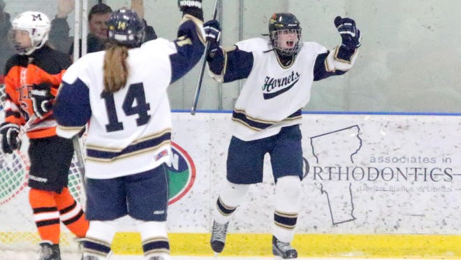 Olivia Miller-Johnson celebrates her game clinching goal during the Hornets 3-1 victory over Middlebury.