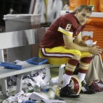Former MSU quarterback Kirk Cousins, left, and Robert Griffin III have been together with the Washington Redskins for three years. There are questions now whether Griffin will remain the starter and whether Cousins will be back in Washington.