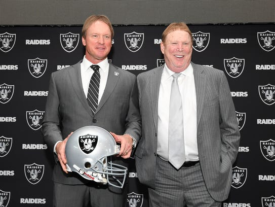 Jon Gruden (L) poses with Oakland Raiders owner Mark