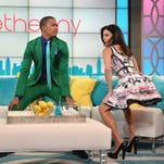 Nick Cannon dances with Bethenny Frankel during taping of the premiere of her talk show in New York.