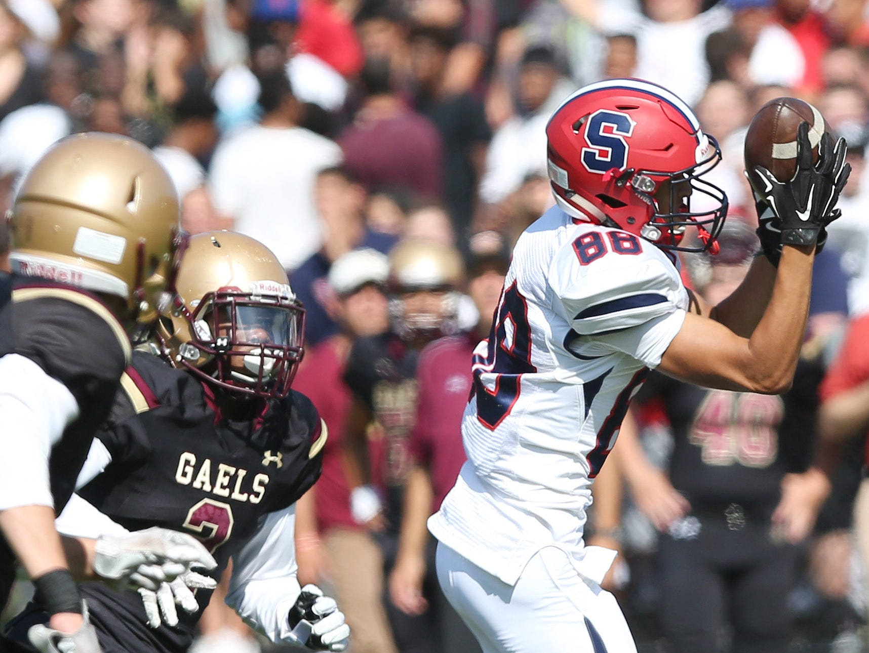 Stepinac's Brandon Gasparre (88) catches a pass over the middle against Iona during football action at Iona Prep in New Rochelle Sept. 17, 2016. Stepinac won the game 42-34.