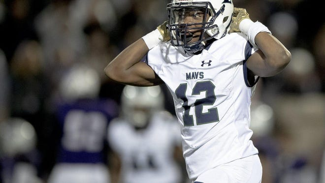 McNeil's Mekhai Coleman, celebrating a fumble recovery against Cedar Ridge last fall, said football has always been his favorite sport, even though he enjoys basketball too.
