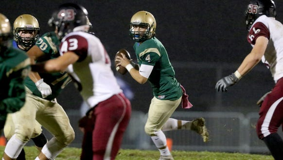 McKay's Noah Tavera (4) runs with the ball in the first