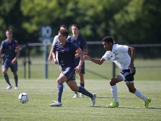 Norwalk's Kason Crall kicks the ball down the field