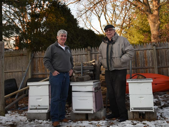 Dan Harrison, left, a relatively new beekeeper from Dumont, and Werner Mai from Cresskill, who was a beekeeper for decades and acts a a mentor to Harrison, pose for photos near Harrison's bee boxes. They discuss how bill S1975 would affect local beekeepers in New Jersey on Tuesday, Jan. 9, 2018.