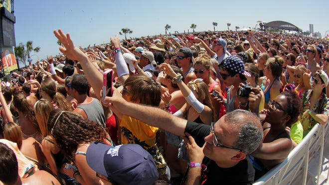 Tens of thousands crowd the public beach in Gulf Shores, Ala., as Bastille performs on the Chevrolet Stage at the 2014 Hangout Music Fest. Limited early bird tickets for the 2015 festival go on sale Wednesday.