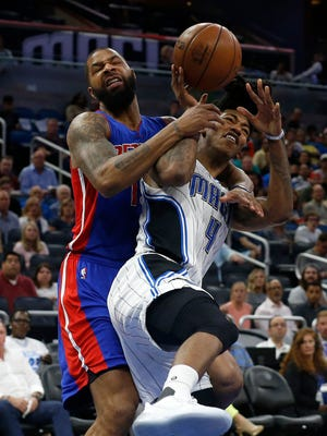 Pistons forward Marcus Morris (13) fouls Magic guard Elfrid Payton (4) during the second half of the Pistons' 115-87 loss Friday in Orlando, Fla.