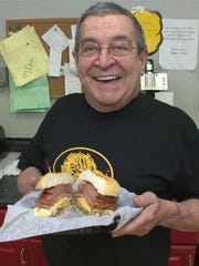 Ralph Marotta Sr. holds a Slater's Slider at his deli in Middletown. Readers chose Slater's Deli as the best place for pork roll at the Shore.