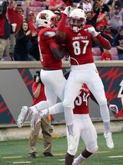 Lamar Jackson (left) and Jaylen Smith (right) will be reunited in Baltimore after their time at U of L.