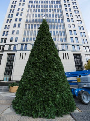 In a first, the city is using an artificial Christmas tree this year because downtown construction prevents a crane from brining in the traditional 45- to 50-foot tree for the holidays. Decorations will soon cover the holiday symbol at Fourth and Jefferson streets.