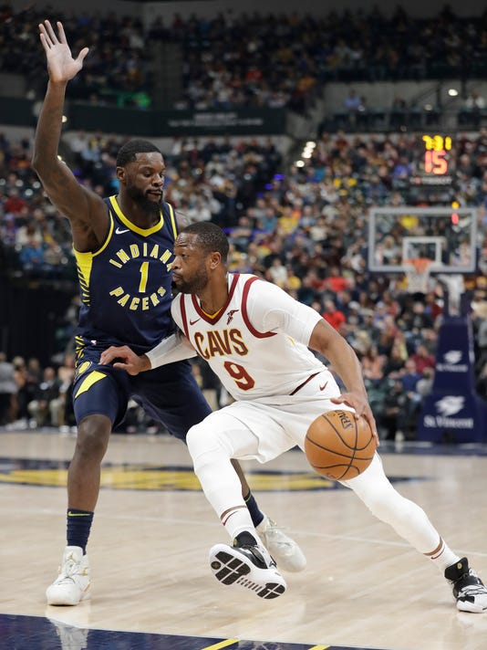 Cleveland Cavaliers' Dwyane Wade (9) goes to the basket against Indiana Pacers' Lance Stephenson during the first half of an NBA basketball game Friday, Dec. 8, 2017, in Indianapolis. (AP Photo/Darron Cummings)