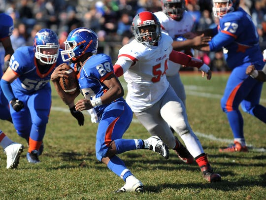 Millville's Clayton Scott (28), Vineland's Anthony