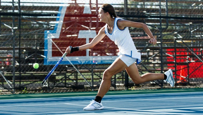 Mukwonago No. 4 singles player Ashley LaBelle runs down a dropshot during a match against Arrowhead last year.