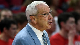 North Carolina Tar Heels head coach Roy Williams reacts to a call during the second half against the North Carolina State Wolfpack at PNC Arena.